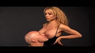 Dominatrix Gia Darling and her slave