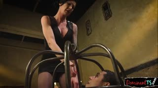 Dominatrix playing with the slave's ass